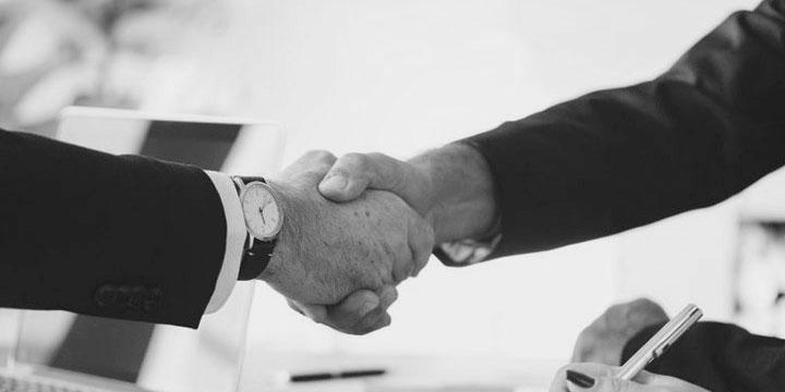 Partners shaking hands black & white image