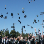 Graduates throwing their cap
