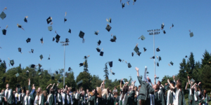 Graduates throwing their cap