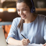 Woman with headphones digital learning